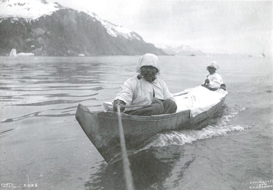 Tlingit canoe receiving a tow in Glacier Bay. 1899